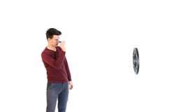 Teenager man wearing a sweater throwing when play darts isolated Royalty Free Stock Photography