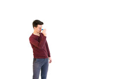 Teenager man wearing a sweater throwing when play darts isolated Royalty Free Stock Photos