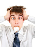 Teenager with Many Cigarettes Stock Photography