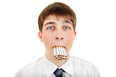 Teenager with Many Cigarettes Royalty Free Stock Photo