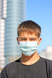 Teenager in the mask Stock Photos