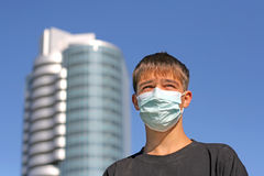 Teenager in the mask Stock Image