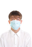 Teenager in mask Royalty Free Stock Image
