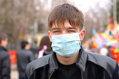 Teenager in mask Stock Images