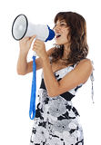 Teenager with megaphone. Teenager speaking through a megaphone over white background royalty free stock images