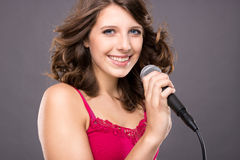 Teenager with microphone Stock Images
