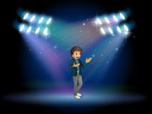 A teenager in the middle of the stage Royalty Free Stock Images