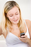 Teenager with mobile phone Stock Images