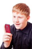 Teenager with mobile phone Royalty Free Stock Photos