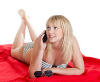 Teenager with mobile phone. Happy young blond woman with mobile phone royalty free stock photos