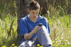 Teenager and mobile phone Stock Image