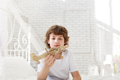 Teenager with model paper airlplane in room Royalty Free Stock Photos