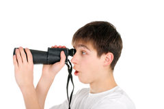 Teenager with monocle. Amazed teenager is spying for someone Stock Image