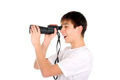 Teenager with monocle. Amazed teenager is spying for someone Stock Images