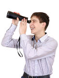 Teenager with Monocle. Cheerful Teenager is Spying for Someone on the White Background Stock Images