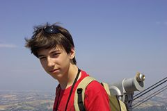 Teenager and monocular. Teenager on a viewing platform stock photos
