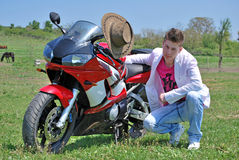 Teenager on a motor Stock Images