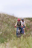 Teenager on the mountain bike. Teenager and young woman on the mountain bike Stock Photography