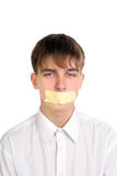 Teenager with mouth sealed Stock Images