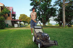 Teenager Mowing Lawn Royalty Free Stock Photos