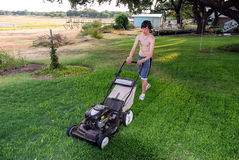 Teenager Mowing Lawn Stock Photo