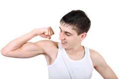 Teenager Muscle Flexing Stock Images