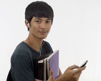 Teenager with music and books Stock Photography