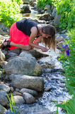 Teenager and natural creek Stock Photography
