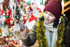 Teenager  near counter with Christmas decoration Stock Images