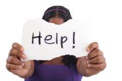 Teenager needing help. Teenager with help sign.  Needing help Stock Images