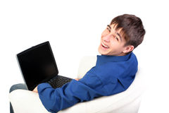 Teenager with notebook. Teenager sitting in armchair with notebook Stock Image