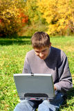 Teenager with notebook. On the meadow Stock Photos