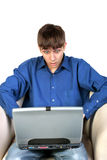 Teenager with notebook. Shocked teenager sitting with notebook Royalty Free Stock Photo