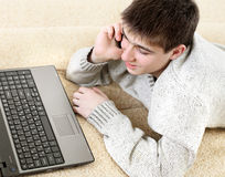 Teenager with notebook and phone Royalty Free Stock Images