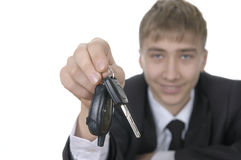 Teenager offering bunch of car keys Royalty Free Stock Image