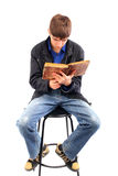 Teenager with old book. Teenager reads old book isolated on the white Stock Photography