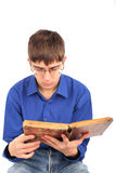 Teenager with old book Royalty Free Stock Photos