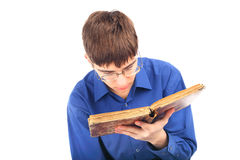 Teenager with old book. Teenager reads old book isolated on the white Royalty Free Stock Photo