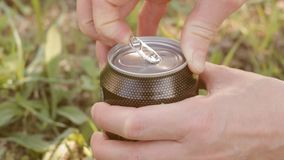 Teenager opens can with drink stock video footage