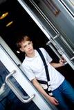 Teenager opens door of cafe Stock Images