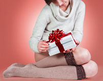 Teenager opens New Year present Royalty Free Stock Photography
