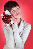 Teenager opens New Year present Royalty Free Stock Images