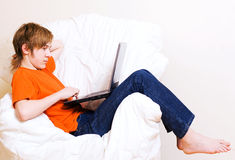 The teenager in an orange t-shirt Stock Images