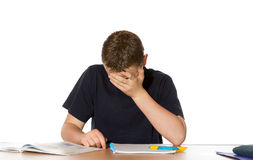 Teenager overwhelmed by his studies royalty free stock photos