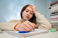 Teenager overworked with homework stock image