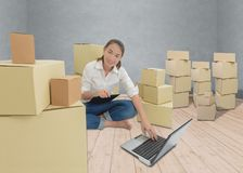 Teenager owner business woman work at home with Clipboard, lapto stock photography