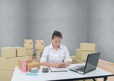 Teenager owner business woman work at home with smartphone, lapt stock image