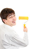 Teenager with Paint Roller Royalty Free Stock Image