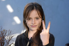 Teenager with painted fingernails. Teenage girl with headphone shows her painted fingernails, making victory gesture Stock Images
