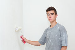 Teenager painting wall to white at home Royalty Free Stock Photo